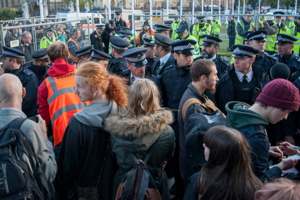 Police arrest Occupy Democracy protesters on Trafalgar Square. 21 October, 2014.